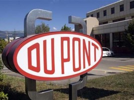DuPont will dismiss nearly 2,000 employees in a global merger with Dow Chemical