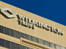 A Federal Court instituted a criminal proceeding  against a financial holding company Wilmington Trust Corp.