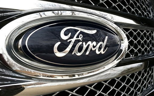 Ford reported smaller-than-expected quarterly losses, but restructuring is still ongoing