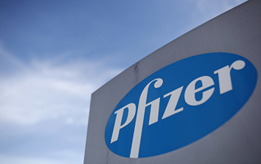 Pfizer reported earnings below estimates and lowered its annual forecasts