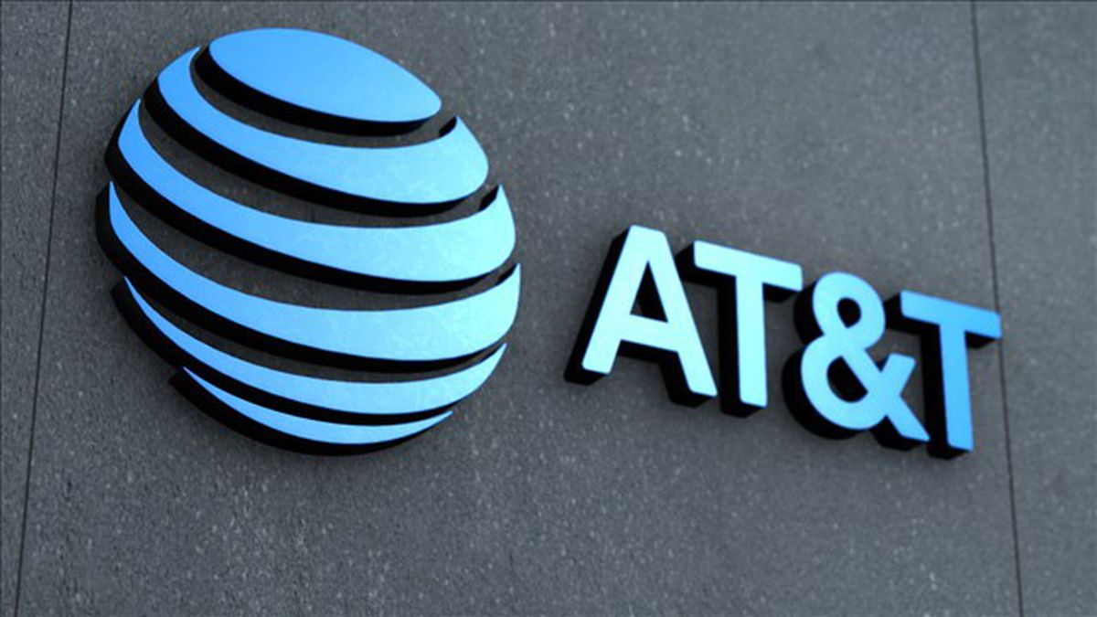 AT&T's quarterly revenues exceeded estimates after adding 645,000 new telephone subscribers